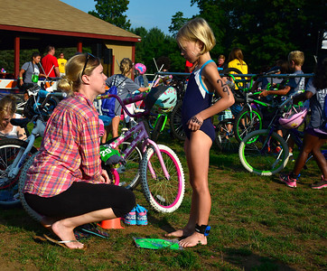 8/6/2016 Mike Orazzi | Staff Rebecca Clampett talks with her daughter Brynn about the Race4Chase Finale event at YMCA Camp Sloper on Saturday morning.