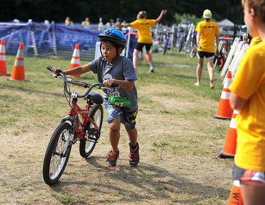8/6/2016 Mike Orazzi   Staff Samuel Lackey competes in the bike portion during the Race4Chase Finale event at YMCA Camp Sloper on Saturday morning.