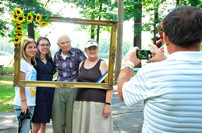 "8/6/2016 Mike Orazzi | Staff Olha Luchka, along with Maria, Wiroslaw and Patricia  Snihurowych, during the ""POL-UKI"" Polish/Ukrainian Festival held at Falcon Field in New Britain Saturday."