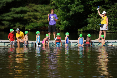 8/6/2016 Mike Orazzi | Staff The swim portion during the Race4Chase Finale event at YMCA Camp Sloper on Saturday morning.