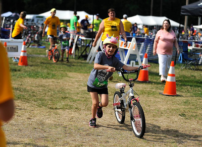 8/6/2016 Mike Orazzi | Staff Olivia Hurley competes in the bike portion during the Race4Chase Finale event at YMCA Camp Sloper on Saturday morning.