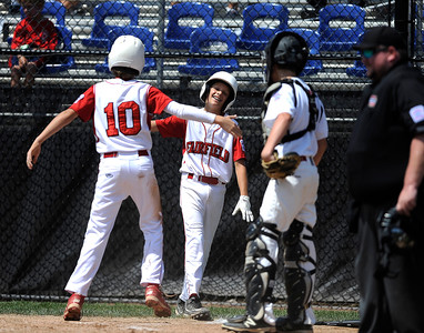 8/12/2016 Mike Orazzi | Staff Connecticut's Matthew Sawyer (10) and Michael Iannazzo (7) celebrate after scoring during the Eastern Regional Little League Tournament at Breen Field Friday.