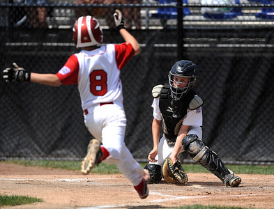 8/12/2016 Mike Orazzi | Staff Connecticut's Sean McAdams (8) as Massachusetts' David Blair (7) prepares to tag him out during the Eastern Regional Little League Tournament at Breen Field Friday.
