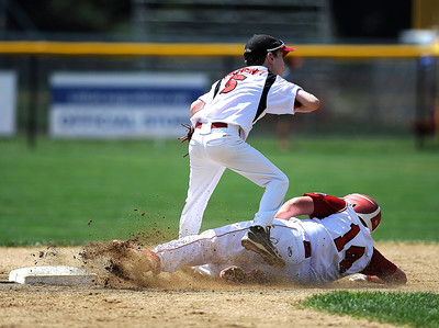 8/12/2016 Mike Orazzi | Staff Connecticut's Richie Kerstetter (14) forced out at second while sliding under Massachusetts' Tyler McChesney (5) at second base during the Eastern Regional Little League Tournament at Breen Field Friday.