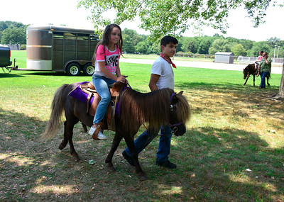 8/12/2016 Mike Orazzi | Staff Ellie Cater while riding a pony during Plainville Fun Day activities Friday at Norton Park.