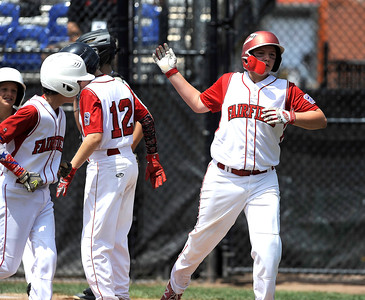 8/12/2016 Mike Orazzi | Staff Connecticut's Richie Kerstetter (14) rips a home run during the Eastern Regional Little League Tournament at Breen Field Friday.