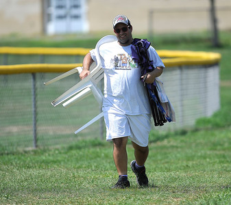 8/12/2016 Mike Orazzi | Staff Coachie during the Eastern Regional Little League Tournament at Breen Field Friday.