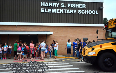 8/31/2016 Mike Orazzi | Staff Fisher Middle School students arrive on the first day of school Wednesday morning in Plymouth.