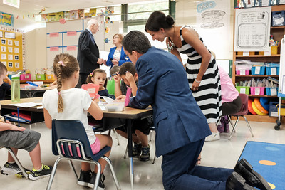 083116  Wesley Bunnell | Staff  Governor Dannel Malloy kneels at a table of students in Dara Flom's first grade classroom as he visited Emma Hart Willard Elementary School on Wednesday Aug 30.