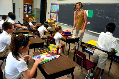 8/31/2016 Mike Orazzi | Staff St. Joseph School Second Grade teacher Trudy Ravita on the first day school for parochial students Wednesday morning.