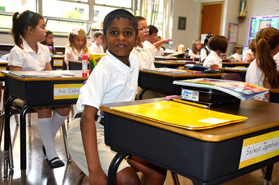 8/31/2016 Mike Orazzi | Staff St. Joseph School Second Grade student Selwyn Ignatius on the first day school for parochial students Wednesday morning.
