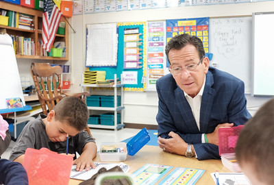 083116  Wesley Bunnell | Staff  Governor Dannel Malloy sits with students in Dara Flom's first grade class at Emma Hart Willard Elementary School on Wednesday Aug 30. On the left is student Cooper Ramirez.