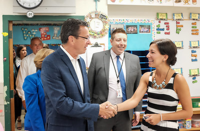 083116  Wesley Bunnell | Staff  Governor Dannel Malloy shakes hands with Berlin's Teacher of the Year Dara Flom while visiting Emma Hart Willard Elementary School on Wednesday Aug 30.