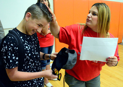 8/31/2016 Mike Orazzi | Staff Eli Terry Jr. Middle School student Anthony Nastri removes his hat at the request of teacher Stephanie Colella on the first day of school Wednesday morning.