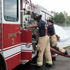 083116  Wesley Bunnell | Staff<br /> <br /> New Britain firefighter Josh Aponte, shown left, practices pump operations on Engine 2 with the help of Lt. Jonathan Turano on Wednesday afternoon at Willow Brook Park. Josh recently completed his year long probationary period.