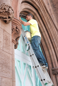 080316  Wesley Bunnell | Staff  Sean Lynch of Eagle Restoration paints the front doors of South Congregational Church on Wednesday afternoon.