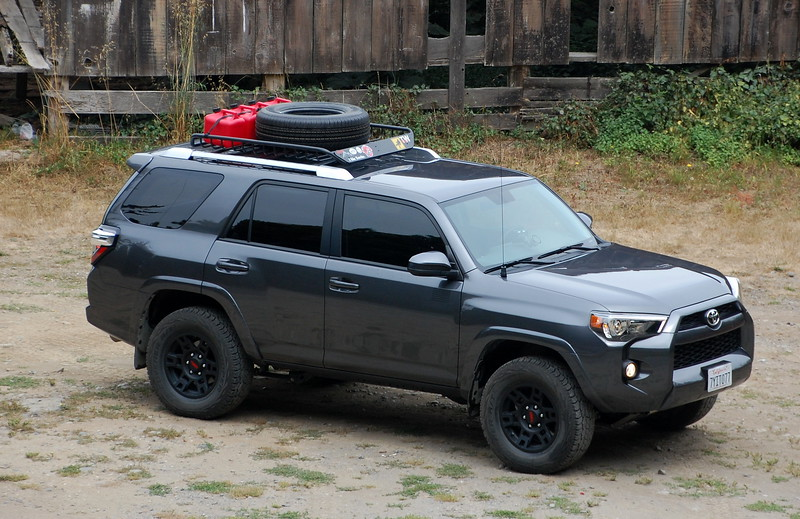 "Day 1, Ferndale California to Birch Bay Washington, 737 miles<br /> <br /> Here's our vehicle, the day of the trip.  This is not only our means of travel, but it's our living quarters.<br /> <br /> It's a 4 wheel drive Toyota 4Runner, with some simple mods useful for camping and remote exploration.  It has the rear seats removed and a wooden platform installed to accommodate our sleeping area and storage, more aggressive all terrain tires, a Bilstein off-road suspension, TRD Pro off road wheels, RCI aluminum skid plates, a HAM radio, a 12 ga shotgun mounted to the interior rear ceiling, tinted windows, a roof basket which carries a second spare tire and 10 gallons of fuel, dual GPS units, an air compressor on board, and extra power outlet options including an inverter for powering 120V AC equipment.<br /> <br /> Day 1 was mostly a long slog in the truck up US 199 to Interstate 5, which we then took up through Oregon and Washington.  Nothing notable, save for the fact that traffic around Portland can suck a dick.  We did stop at Cabela's near Eugene Oregon, because you can't be going on a outdoor adventure and not stop in a Cabela's that you pass.  Doing so is un-American.  Frankly, that should be the litmus test to determine if someone is in ISIS or not.  <br /> <br /> DHS Agent: ""You have an epic beard and are clearly outdoorsy, living in a cave and such.  So answer me this: do you stop at every Cabela's you pass?""  <br /> <br /> Guy in turban, with overcoat on in 110 degree heat: : ""Cabela's?  No!  No no no no!  No Cabela's.  Bomb vest.  Allahu Akbar!""  <br /> <br /> That guy is totally in ISIS.  Homeland Security, take notes.<br /> <br /> Anyway, we got to just a few miles shy of the Canadian border, in Birch Bay Washington; and we set up camp at the state park there.  I should note here that I refuse to pay for camping on government property; it's bullshit.  We already pay taxes to support those projects, and I'm not using any resources at all - I'm literally stopping for 6 hours on a 8' x 12' patch of ground.  So, I just set up camp and let the chips fall where they may if the man comes sniffing around.  So far in this life I'm like 2800:1 so the odds are in my favor.  Add to this that Birch Bay is a total shit-hole state park, and smells like oil because the fucking BP refinery is next to it, so I felt pretty morally okay with not dropping my money in the collection plate.<br /> <br /> So we are cooking dinner and here comes the ranger.  She wasn't fucking around, and was going to get the state's money out of us one way or another.  After playing twenty questions about why we didn't register, she scratches out a registration form for us and collects $35.  God damn it.  $35 to sleep in some fuck-hole for six hours?  <br /> <br /> Meredith was displeased too, but at least the ranger pointed out that the campground had showers, so that was a plus in her book and might almost make the fee tolerable.  Until the next morning, when we learned that the showers were coin operated and required further payment.  <br /> <br /> Bah.  In my notebook I kept to keep track of days, this was my entry for day 1: <br /> <br /> ""Interstate :( <br /> $35 park and pay showers :( <br /> FU Washington""<br /> <br /> Sums it up."