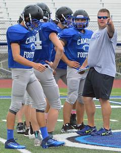 KYLE MENNIG – ONEIDA DAILY DISPATCH Camden head coach Jake Bates talks to his team at practice in Camden on Thursday, Aug. 24, 2017.