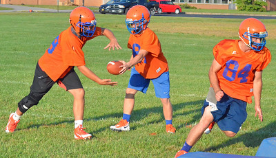 KYLE MENNIG – ONEIDA DAILY DISPATCH Oneida football players run through a drill on the first day of practice in Oneida on Monday, Aug. 14, 2017.