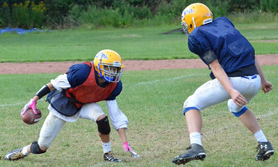 KYLE MENNIG – ONEIDA DAILY DISPATCH A Cazenovia football player loses his footing while running a play at practice in Cazenovia on Thursday, Aug. 24, 2017.
