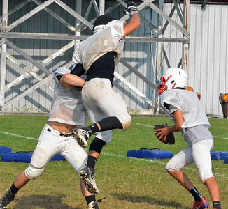 KYLE MENNIG – ONEIDA DAILY DISPATCH Vernon-Verona-Sherrill football players run through a play at practice on Tuesday Aug. 22, 2017.