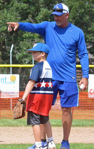 KYLE MENNIG – ONEIDA DAILY DISPATCH Former World Series MVP Bret Saberhagen, right, provides pitching instruction to Vincent VanPatten, 10, of Oneida during a clinic at Oneida High School on Saturday, Aug. 12, 2017.