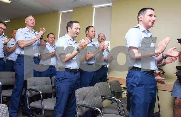 080917 Wesley Bunnell | Staff A retirement ceremony was held for Coast Guard Chief Scott Johnson at the New Britain Fire Department Headquarters on Wednesday at noon. Johnson who is battling colorectal cancer has worked as a firefighter in New Britain for approximately 10 years. Coast Guard members applaud at the conclusion of the retirement ceremony.