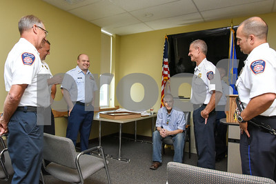 080917  Wesley Bunnell | Staff  A retirement ceremony was held for Coast Guard Chief Scott Johnson at the New Britain Fire Department Headquarters on Wednesday at noon. Johnson who is battling colorectal cancer has worked as a firefighter in New Britain for approximately 10 years. Johnson sits as he is congratulated by fellow firefighters and Coast Guard members.