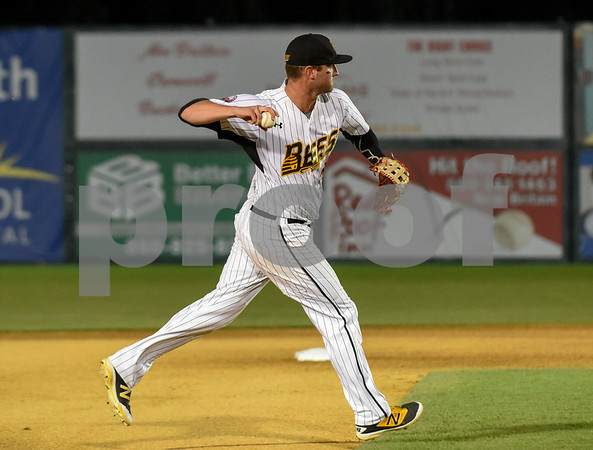 080917 Wesley Bunnell | Staff The New Britain Bees vs the Sugarland Skeeters on Wednesday evening. Third baseman Jon Griffin (33) fields and throws to first base for the out.