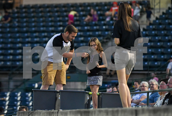 080917 Wesley Bunnell | Staff The New Britain Bees vs the Sugarland Skeeters on Wednesday evening. A young Bees fan plays the game whats in the box and wins a pair of tickets.