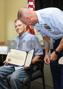 080917  Wesley Bunnell | Staff  A retirement ceremony was held for Coast Guard Chief Scott Johnson at the New Britain Fire Department Headquarters on Wednesday at noon. Johnson who is battling colorectal cancer has worked as a firefighter in New Britain for approximately 10 years.  Johnson smiles as he holds a commendation award from the Coast Guard just after having the commendation pinned by Master Chief Dale McCurry.