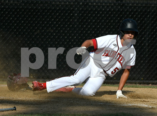 8/9/2017 Mike Orazzi | Staff Fairfield American's Christian Smith (5) slides safely into home during the Eastern Regional Little League Tournament at Breen Field in Bristol Wednesday.