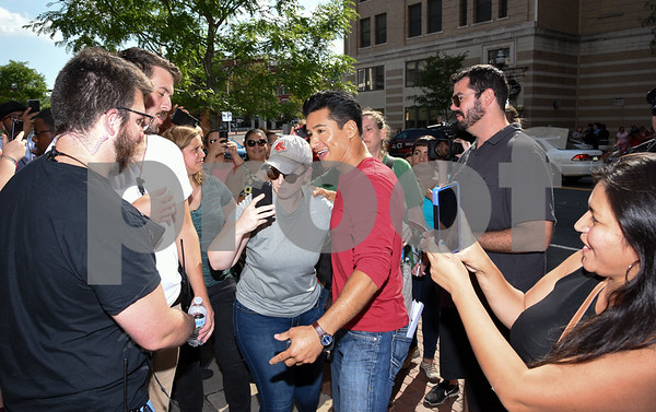 080917 Wesley Bunnell | Staff Filming began at Amato's Toy & Hobby Store on Main St on Wednesday afternoon for a movie starring Mario Lopez and Melissa Joan Hart to be released in December 2017. Mario Lopez is greeted by fans looking to take selfies with the actor.