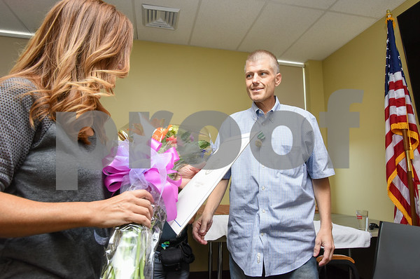 080917 Wesley Bunnell | Staff A retirement ceremony was held for Coast Guard Chief Scott Johnson at the New Britain Fire Department Headquarters on Wednesday at noon. Johnson who is battling colorectal cancer has worked as a firefighter in New Britain for approximately 10 years. Scott presents flowers to his wife Caroline during the ceremony.