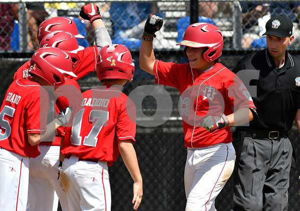 8/9/2017 Mike Orazzi | Staff New Jersey's Chris Cartnick (23) celebrates his grand slam during the Eastern Regional Little League Tournament in Bristol Wednesday afternoon.