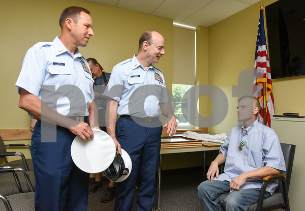 080917 Wesley Bunnell | Staff A retirement ceremony was held for Coast Guard Chief Scott Johnson at the New Britain Fire Department Headquarters on Wednesday at noon. Johnson who is battling colorectal cancer has worked as a firefighter in New Britain for approximately 10 years. Johnson is congratulated by fellow service members.