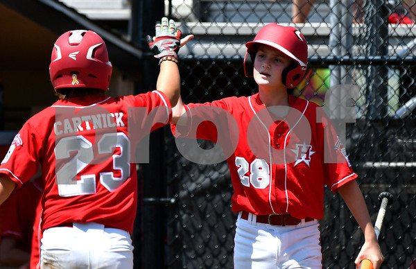 8/9/2017 Mike Orazzi | Staff New Jersey's Chris Cartnick (23) and Anthony Abbonizio (28) celebrate during the Eastern Regional Little League Tournament in Bristol Wednesday afternoon.