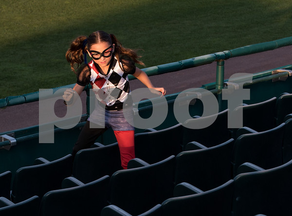 081617 Wesley Bunnell | Staff A young fan dressed as Harley Quinn runs after a foul ball during a super hero and princess night at the New Britain Bees baseball game versus the Southern Maryland Blue Crabs at New Britain Stadium.