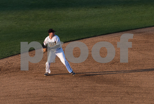 081617 Wesley Bunnell | Staff New Britain Bees shortstop Michael Baca (5) fields a ball as his shadow stretches across the infield in the late day sun on Wednesday evening in a game against the Southern Maryland Blue Crabs.