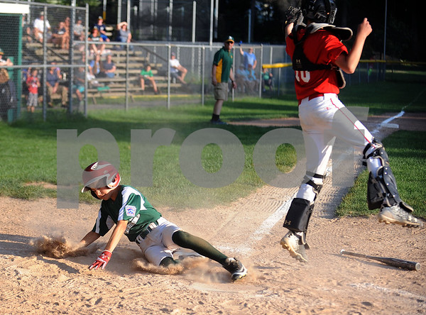 8/16/2017 Mike Orazzi | Staff Forestville's Cole Varano (4) scores as Edgewood's Harry Ross (10) takes the throw during the City Series Wednesday evening in Bristol.