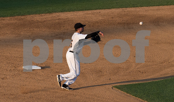 081617 Wesley Bunnell | Staff New Britain Bees shortstop Michael Baca (5) throws to first as his shadow stretches across the infield in the late day sun on Wednesday evening in a game against the Southern Maryland Blue Crabs.