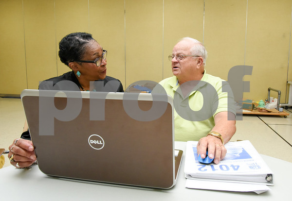 080717 Wesley Bunnell | Staff Barbara Imbac discusses her taxes with AARP Tax Aide volunteer Richard DiMinno at the Berlin Senior Center.