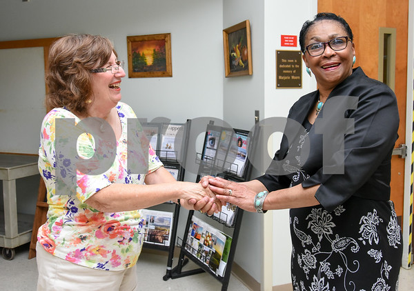 080717 Wesley Bunnell | Staff AARP Tax Aide volunteer Carol Welz shakes hands with Barbara Imbac at the conclusion of her visit at the Berlin Senior Center.