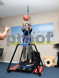 080717  Wesley Bunnell | Staff  Clinical Director of the Southington Fyzical Therapy center Kaitlyn Hamel, catches a weighted ball while standing on a balance apparatus to demonstrate an exercise she recently used on a patient.