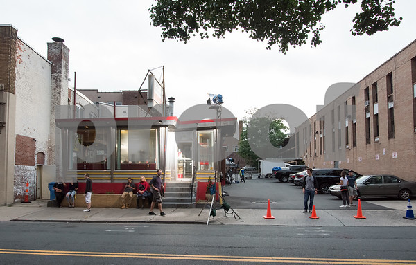 081517 Wesley Bunnell | Staff Background actors sit in front of Miss Washington Diner during filming for the movie Christmas Hours on Tuesday night.