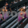 081617  Wesley Bunnell | Staff<br /> <br /> Dressed for super hero and princess night is Elle Connoy, age 7, as she tracks down a foul ball at the New Britain Bees baseball game on Wednesday evening against the Southern Maryland Blue Crabs.