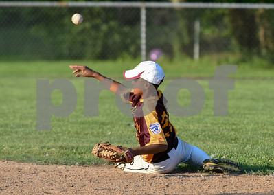 080317  Wesley Bunnell | Staff  The New Britain All Stars vs West Hartford in a 12U Nutmeg State Games baseball game played at Martha Hart Park on Thursday evening. Second baseman Emani Gonzalez (22) throws from the ground for the force out at second base.