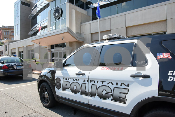 080317 Wesley Bunnell | Staff A New Britain Police Ford Explorer Interceptor parked outside of the police headquarters on Thursday afternoon.