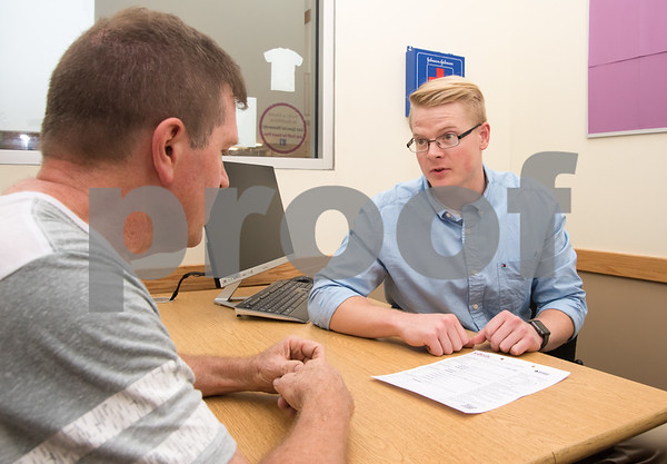 080117 Wesley Bunnell | Staff Healthtrax member Gary Gelinas, L, discusses the results of his body assessment with Physician Liaison for the Healthtrax Physicians Referral Program, P.R.E.P, Tim Cederberg at Healthtrax in Bristol on Tuesday Aug 1st.