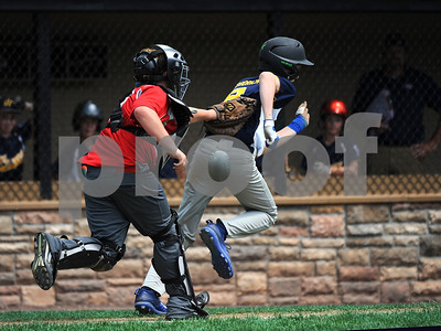 8/10/2017 Mike Orazzi | Staff Vermont's Andrew Goodrich gets tagged out by Maine's Richie Gilboy (19) during the Eastern Regional Little League game at Breen Field in Bristol Thursday.